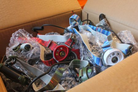 Box of low cost Alpkit Gamma headtorches