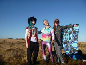 Photo of three members enjoying the Mendips trip